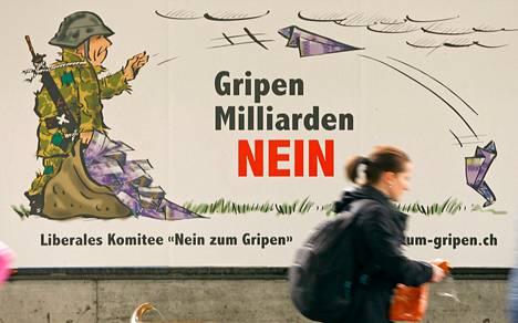 Vaalijuliste Zürichissa kehottaa vastustamaan hävittäjäkauppoja.
