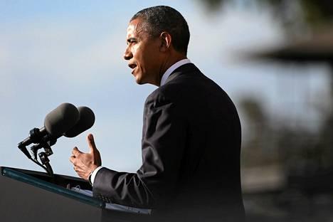Barack Obama puhui  Navy Yard -joukkosurman uhrien muistotilaisuudessa Washingtonissa sunnuntaina.
