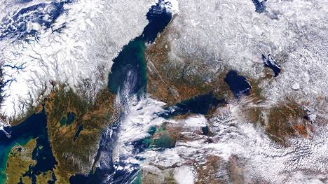 """Winter is loosening its grip on the Northern Hemisphere, and greens and browns are replacing white on the landscape. But the seasonal change in March 2020 in Northern Europe is less dramatic than most years. This natural-color satellite image shows snow cover in Scandinavia and the Baltic region in early spring 2020. It is a composite of two images acquired by the Moderate Resolution Imaging Spectroradiometer (MODIS) on NASA's Terra satellite on March 20 and 21. The composite maximizes the cloud-free area visible from space. While snow covered much of Norway and the northern parts of Sweden and Finland, the southern end of each country appeared snow-free—including the capital cities of Oslo, Stockholm, and Helsinki. (For a seasonal comparison, see this image from March 2018.) The cities were virtually snow-free for much of winter 2019-20. For example, Helsinki saw no new snowfall in January or February, according to news reports. Numerous ski resorts across Europe had to rely on imported and artificial snow. Warm winter temperatures were one reason for the sparse snowfall. According to NOAA, the December 2019 to February 2020 period was the warmest on record in Europe, and the January-February period was the warmest on record for the Northern Hemisphere. """"The strong polar vortex has kept much of the frigid air in the Arctic, leaving the mid-latitudes warmer and generally less snowy than normal,"""" said Jennifer Francis, a scientist at Woods Hole Research Center. NASA Earth Observatory images by Joshua Stevens"""