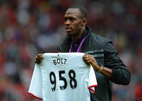 Usain Bolt sai vuonna 2012 pelipaidan, jonka numerot koostuvat hänen 100 metrin maailmanennätyksestä.
