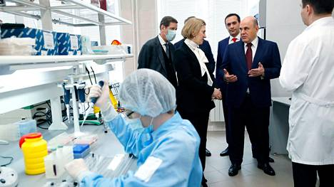 Russian Prime Minister Mikhail Mishustin visits the Vektor State Virology and Biotechnology Center in Novosibirsk on March 5, 2021. LEHTIKUVA / AFP