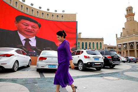 Kiinan presidentin Xi Jinpingin kuva koristi katunäkymää uigurienemmistöisen Xinjiangin autonomisen alueen Kašgarissa syyskuussa 2018.