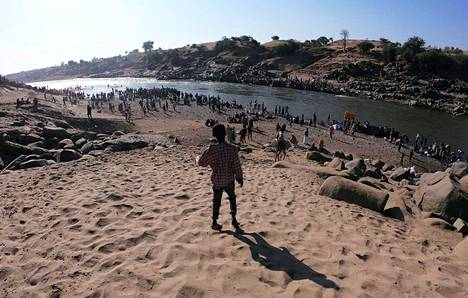 Fleeing residents of the Tigray region crossing the border river between Sudan and Ethiopia at the village of Hamdait on 14 November.