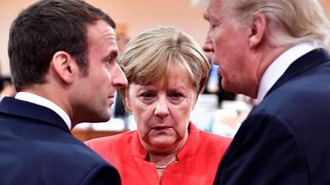 Ranskan presidentti Emmanuel Macron, Saksan liittokansleri Angela Merkel ja Yhdysvaltain presidentti Donald Trump vuonna 2017.