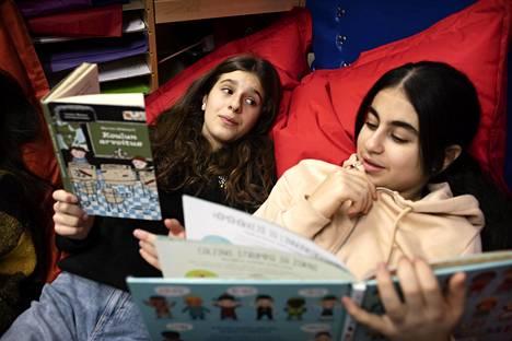 Erjona Maksuti and Avin Zaid Fawzi talk about the books they read in the reading corner.