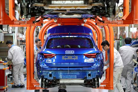 Workers assembled cars at Audi's assembly line at Volkswagen's Tianjin car plant in China in December 2019.