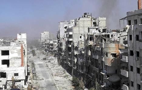Syyrian sisällissota on jatkunut kaksi ja puoli vuotta. Kuva on Homsin kaupungista hallituksen joukkojen syyskuussa suorittaman ilmaiskun jälkeen.