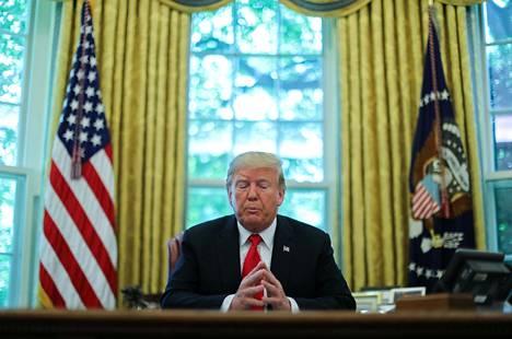 Yhdysvaltain presidentti Donald Trump Valkoisen talon virkahuoneessaan 4. syyskuuta.