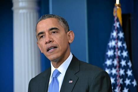Barack Obama puhui Valkoisessa talossa perjantaina.