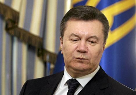 Viktor Janukovytšin yksi viimeisimmistä esiintymisistä oli Ukrainan kiistojen osapuolten välisen sopimuksen allekirjoitustilaisuus presidentinpalatsissa 21. helmikuuta.