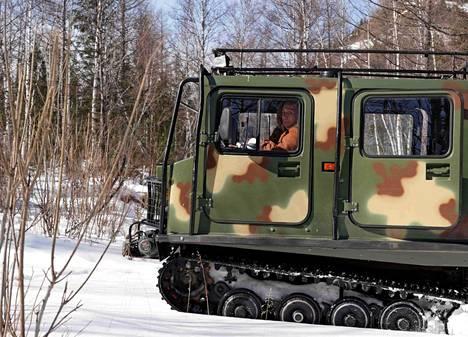 Putin ja Šoigu maastoajoneuvon hytissä.