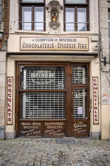 While chocolate shops may be open, many small shops have closed their doors in the center of Brussels.  There are no tourists.