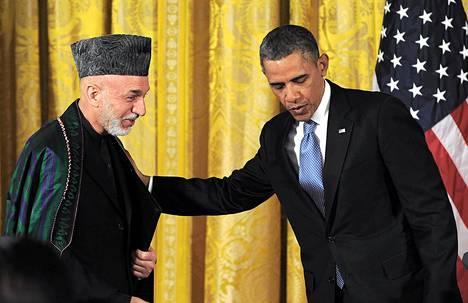 Presidentti Barack Obama tapasi Afganistanin presidentin Hamid Karzain Valkoisessa talossa perjantaina.