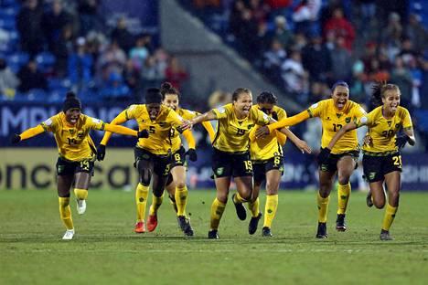 Jamaikan pelaajat riemuitsivat, kun paikka MM-kisoihin varmistui viime lokakuussa.
