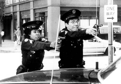 Marion Ramsey and Bruce Mahler in the sixth Police College film The Great Crime Wave from 1989.