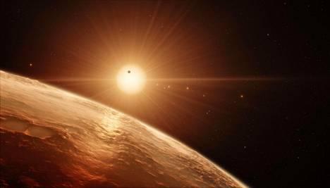 Taiteilijan näkemys himmeästä Trappist-tähdestä ja sen seitsemästä planeetasta.