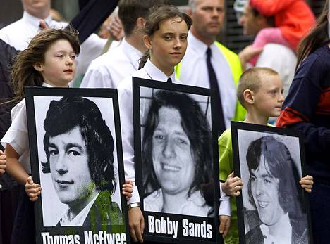 A young girl carries a picture of Bobby Sands on the 20th anniversary of the hunger strike in 2001.