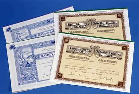 KOP:n eli Kansallis-Osake-Pankin ja SYP:n eli Suomen Yhdyspankin paperisia osakekirjoja 27. tammikuuta 1984.