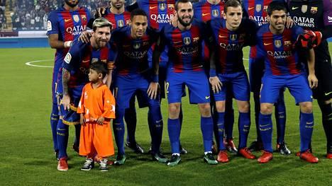 Murtaza Ahmadi pääsi Dohassa Lionel Messin kanssa kentälle.