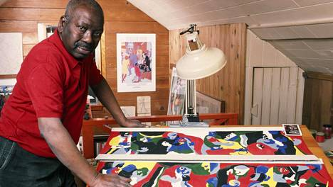 SEATTLE, WA - 1986: Renowned African-American artist and painter Jacob Lawrence poses in his Seattle, Washington studio. Lawrence, who was a professor of art at the University of Washington, died in 2000. (Photo by George Rose/Getty Images)