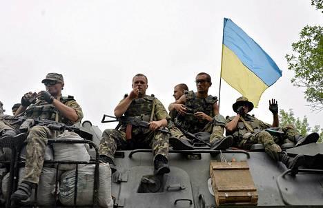 Ukrainalaisia sotilaita Slovjanskin lähettyvillä Itä-Ukrainassa heinäkuun 18. päivänä.