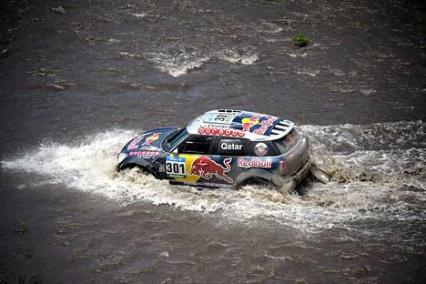 Mini-kuljettaja, Qatarin Nasser Al-Attiyah ja apukuljettaja Ranskan Mathieu Baumel ajamassa Dakar-rallin 15 etapilla Argentiinassa.