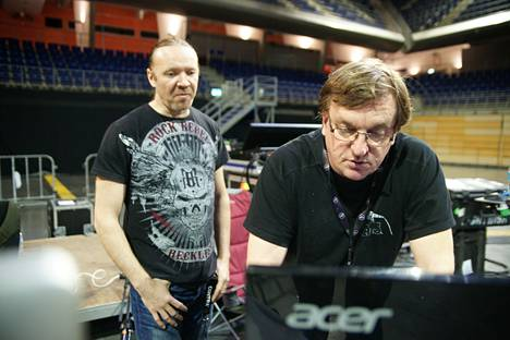 Kimmo Ahola (right) and Nightwish drummer Kai Hahto preparing for the concert behind the mixing table.