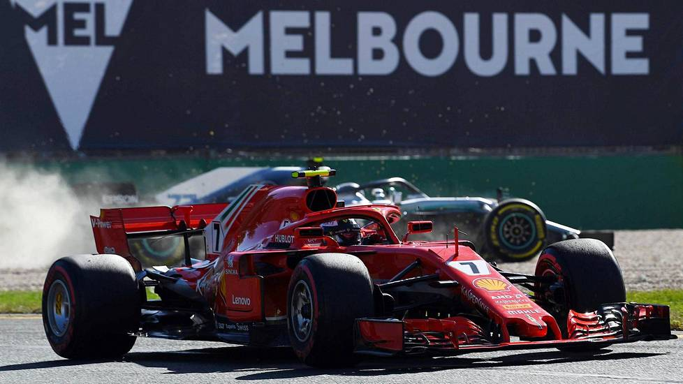 SK319; Ferraris Finnish driver Kimi Raikkonen drives past Mercedes Finnish driver Valtteri Bottas (R) during the second Formula One practice session in Melbourne on March 23, 2018, ahead of the Formula One Australian Grand Prix.