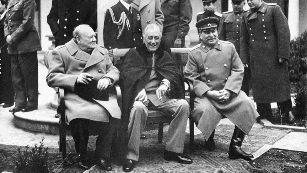 (L-R) British PM Winston Churchill, US Pres. Franklin Roosevelt & Soviet Premier Josef Stalin, sitting on patio together at Yalta conf. to make final plans for defeat of Germany.