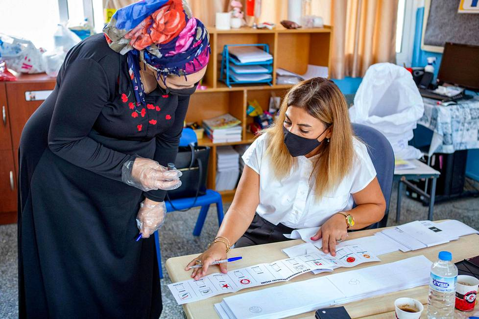 """The woman voted in the presidential election of the """"Turkish Republic"""" of Northern Cyprus in northern Nicosia on 11 October.  The second round of elections is on Sunday, October 18th."""