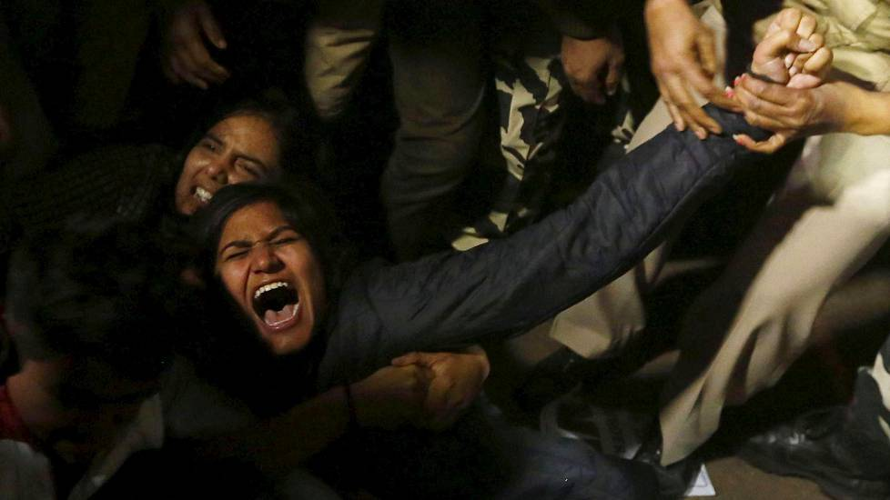 A demonstrator is detained by police during a protest against the release of a juvenile rape convict, in New Delhi, India, December 20, 2015. The youngest of six people convicted of the 2012 gang rape of a woman, in a case that shocked India, was freed on Sunday, a lawyer said, after a court refused to extend his three-year sentence. The case turned a global spotlight on the treatment of women in India, where police say a rape is reported every 20 minutes, and the sentence sparked debate over whether the country is too soft on young offenders. REUTERS/Adnan Abidi - RTX1ZHI1