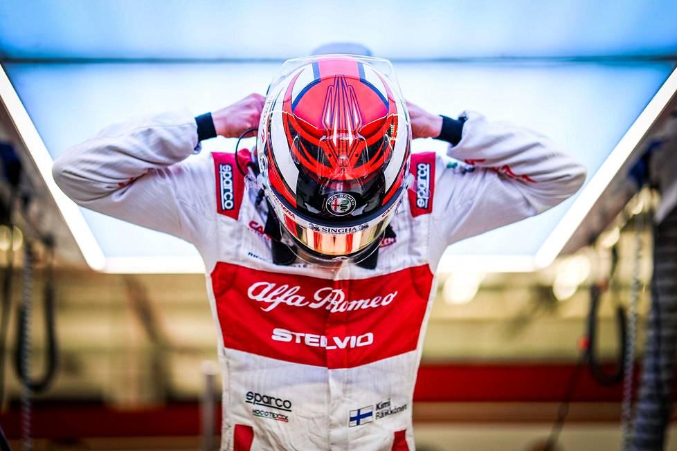 Kimi Räikkönen ja työasu.