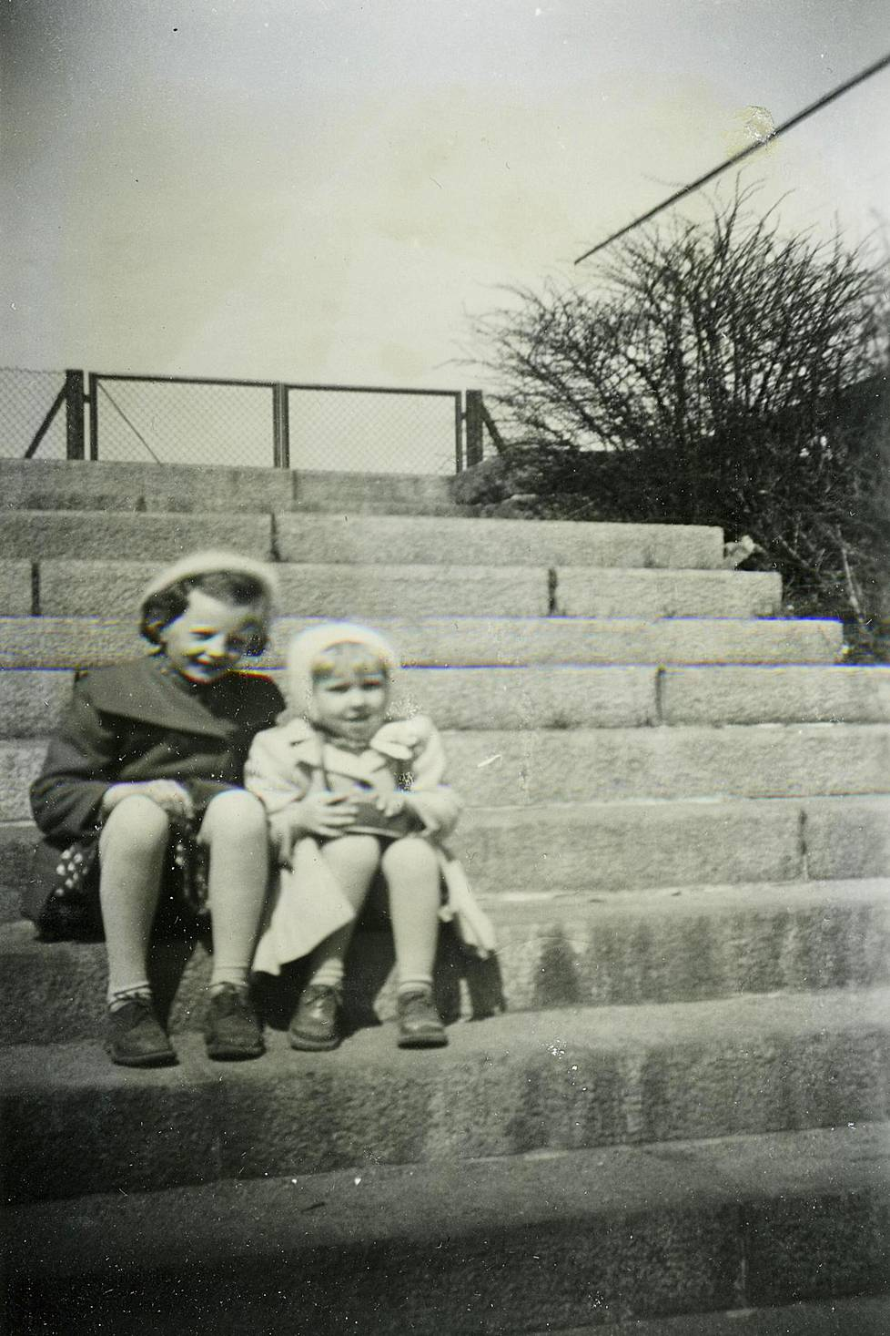 Tuula Stenroos (right) on the steps of the Sports Museum with her sister Paula in the 1950s.