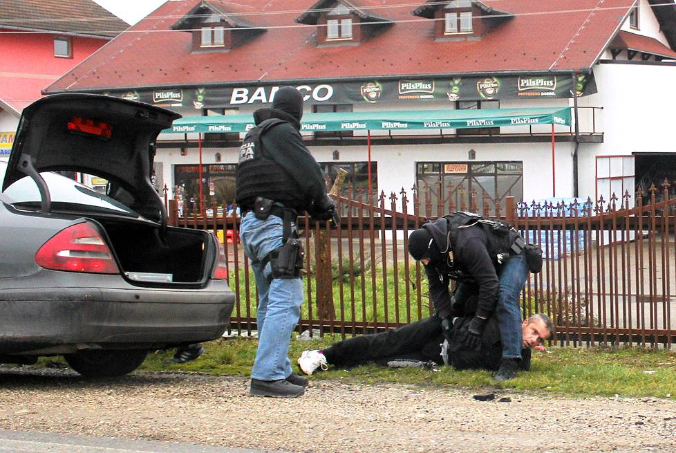 This photo handout on March 13, 2015 by Bosnia and Herzegovinas State Agency for Investigations and Protection (SIPA) shows SIPA officers conducting an actual arrest at an undisclosed location, at one of Bosnias many border crossings towards neighboring EU member state of Croatia, on March 13, 2015.